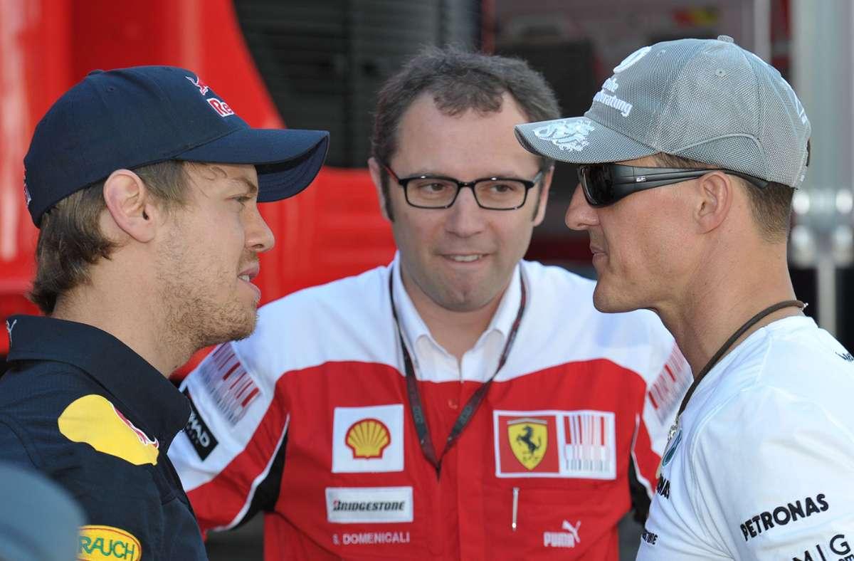 Ein Bild aus der Vergangenheit: Stefano Domenicali (Mitte) unterhält sich mit Sebastian Vettel (links) und Michael Schumacher. Foto: dpa/David Ebener