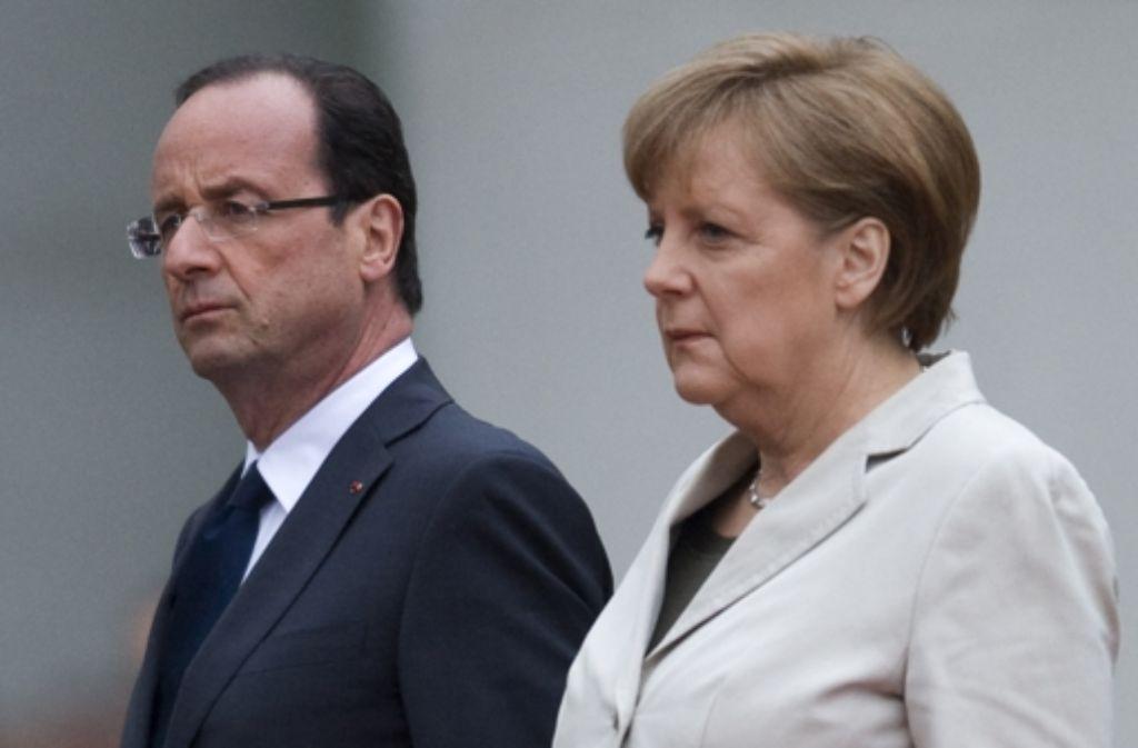 Bundeskanzlerin Angela Merkel und der französische Präsident François Hollande kommen nach Ludwigsburg, Foto: dapd