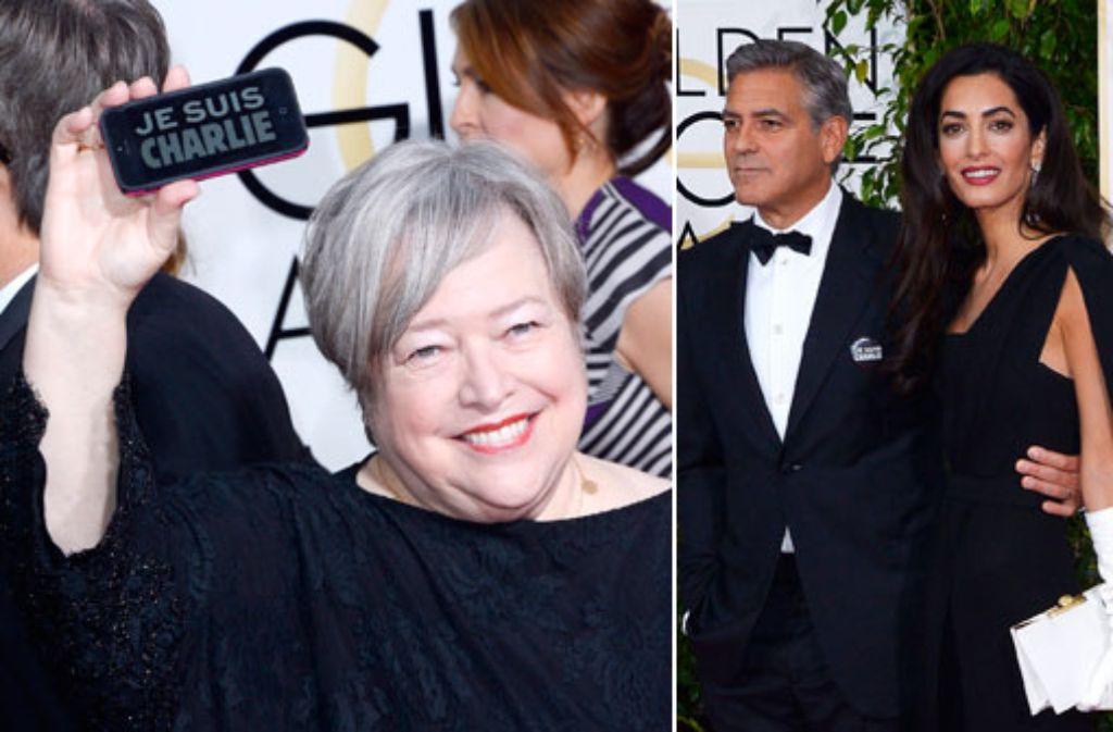 Je suis Charlie: Kathy Bates und George Clooney zeigten bei den Golden Globes ihre Solidarität mit den Opfern von Paris. Foto: dpa