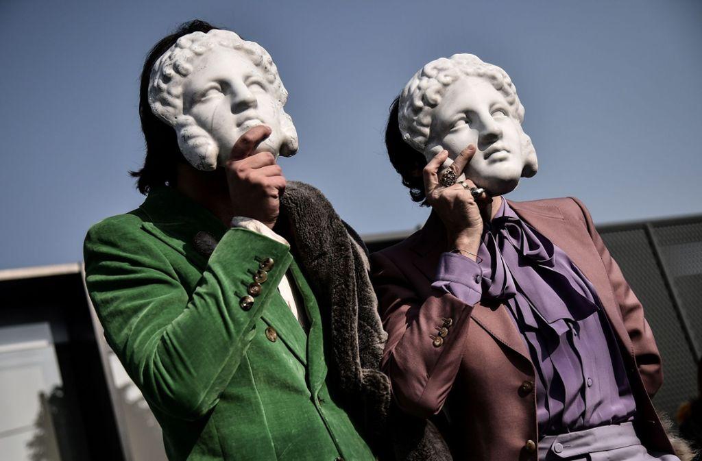 Masken dienten auch als Einladung für die Gucci-Show auf der Mailänder Modewoche. Foto: AFP