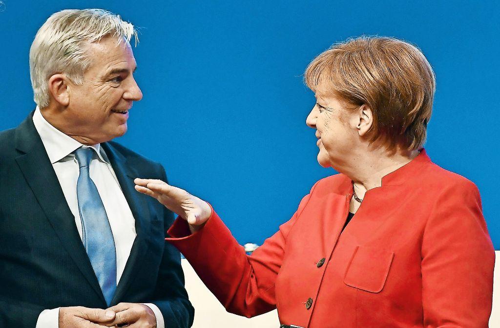 Der Stellvertreter und seine Chefin: Thomas Strobl im Gespräch mit Angela Merkel Foto: AP