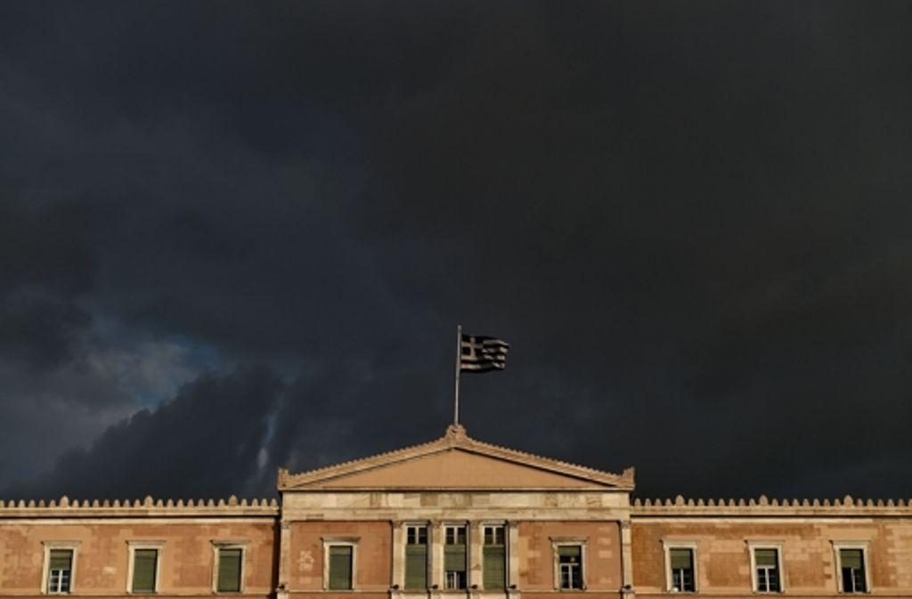 Dunkle Wolken über Athen – muss Griechenland die Eurozone verlassen? Foto: AFP