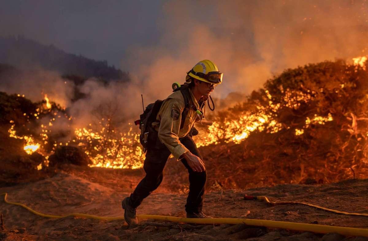 Ob Waldbrand oder Überschwemmung: Die Auswirkungen des Klimawandels spüren wir alle – aber wir alleine können ihn nicht verhindern. Foto: imago/Michael Nigro