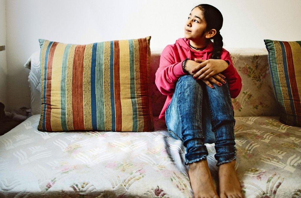 In Stuttgart teilt sich Harnit mit ihren Eltern und ihrer Schwester ein 20-Quadratmeter-Zimmer. Foto: Lichtgut/Leif Piechowski