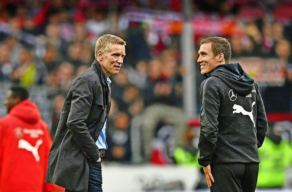 Sportvorstand Jan Schindelmeiser (links) hat Trainer Hannes Wolf von Dortmund nach Stuttgart gelotst – und dafür viel Anerkennung bekommen. Foto: Eibner