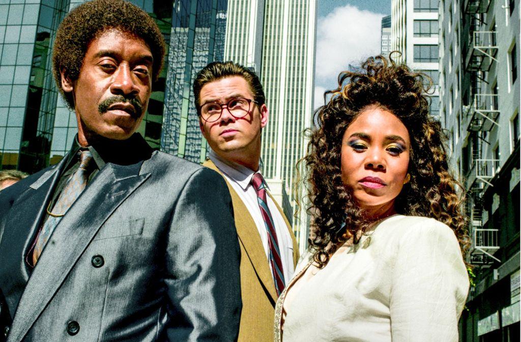Dieses Trio (v. li. Don Cheadle, Andrew Rannells, Regina Hall) will die Wall Street  aufmischen. Foto: Showtime