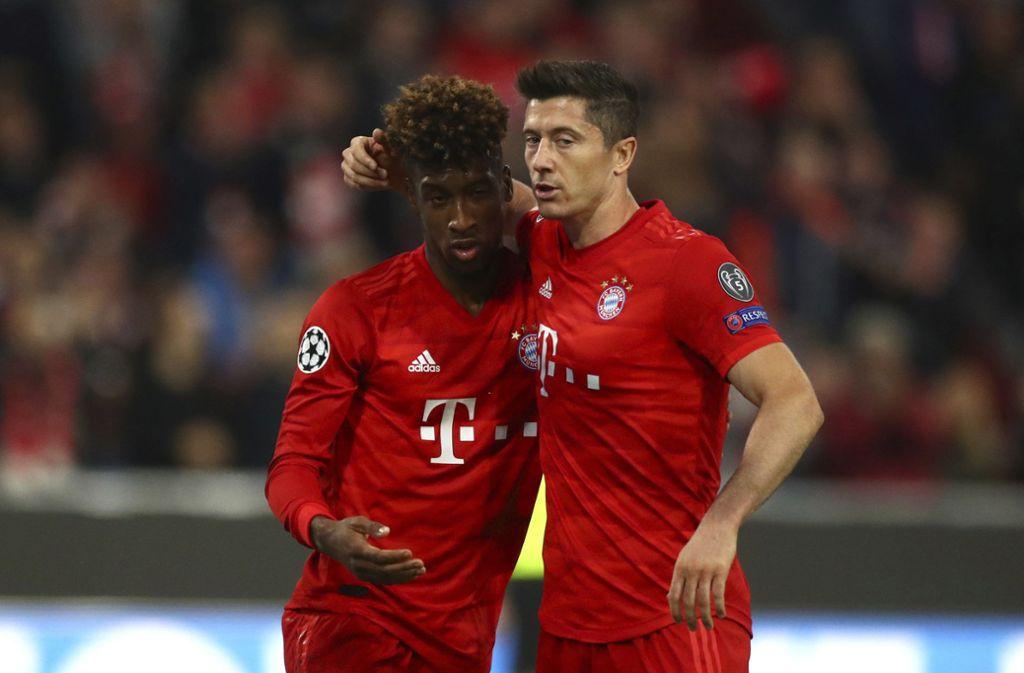 Coman (links) und Lewandowski haben bei getroffen, außerdem noch Müller (nicht im Bild). Foto: AP/Matthias Schrader
