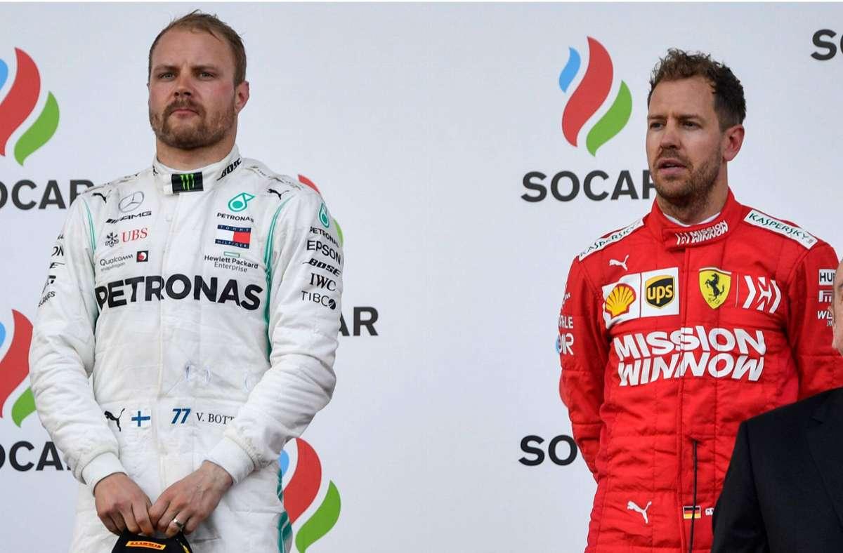 Nach dem Rennen 2019 in Baku standen Valtteri Bottas (li.) und Sebastian Vettel nebeneinander auf dem Podium – eine Szene, die für 2021 unwahrscheinlich scheint. Foto: AFP/ALEXANDER NEMENOV