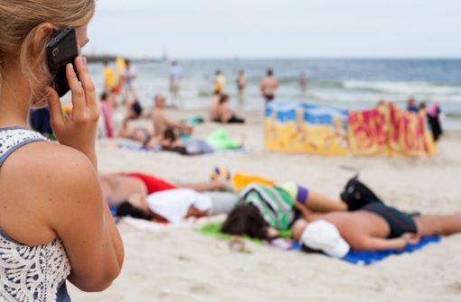 Viele Berufstätige sind  im Urlaub für Chef erreichbar