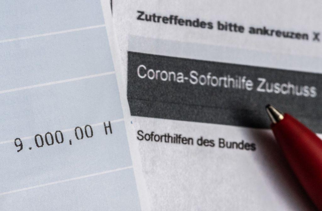 Die Corona-Soforthilfe soll kleinen Firmen helfen, die Corona-Krise zu überstehen. Foto: dpa/Robert Michael