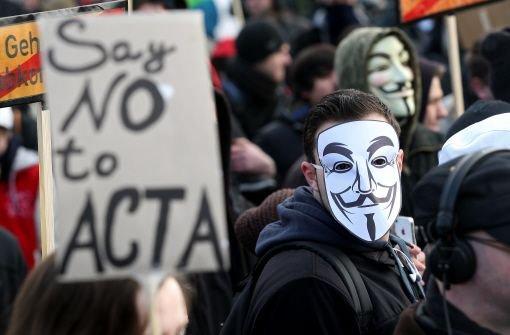 Demonstranten nutzen die Guy-Fawkes-Maske als Protestsymbol. Foto: dapd