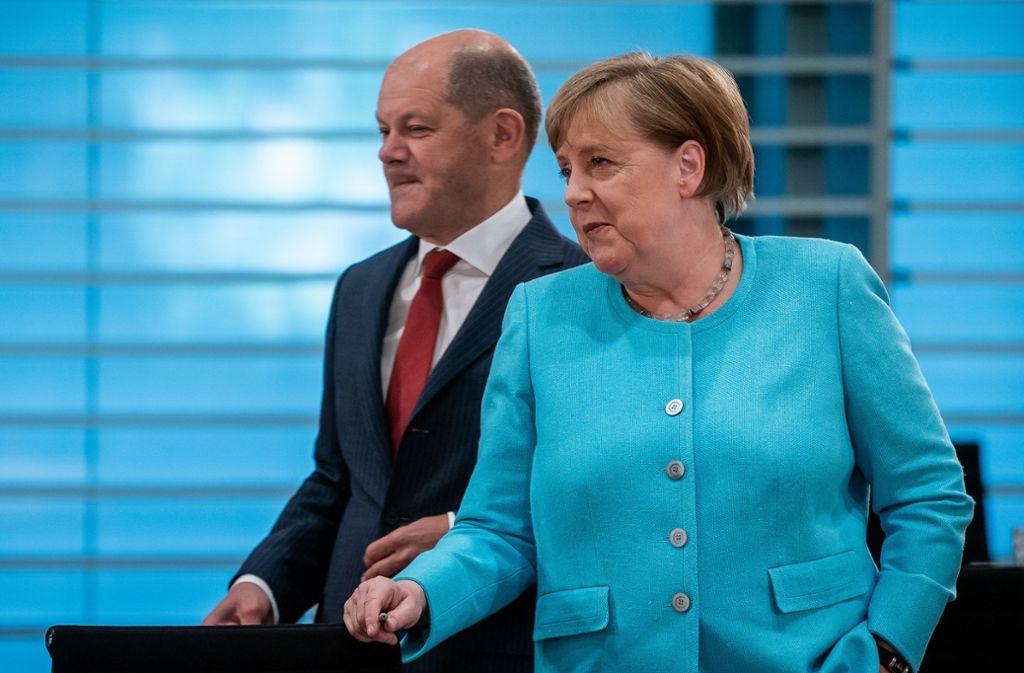 Kanzlerin Merkel und Finanzminister Scholz haben mit den Koalitionsspitzen ein Konjunkturprogramm beschlossen, das bisher ohne Beispiel ist. Foto: dpa/Michael Kappeler
