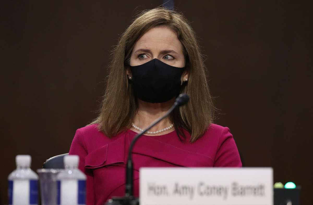 Amy Coney Barrett wurde von  Donald Trump für die Nachfolge der verstorbenen Justizikone Ruth Bader Ginsburg nominiert. Foto: AFP/WIN MCNAMEE