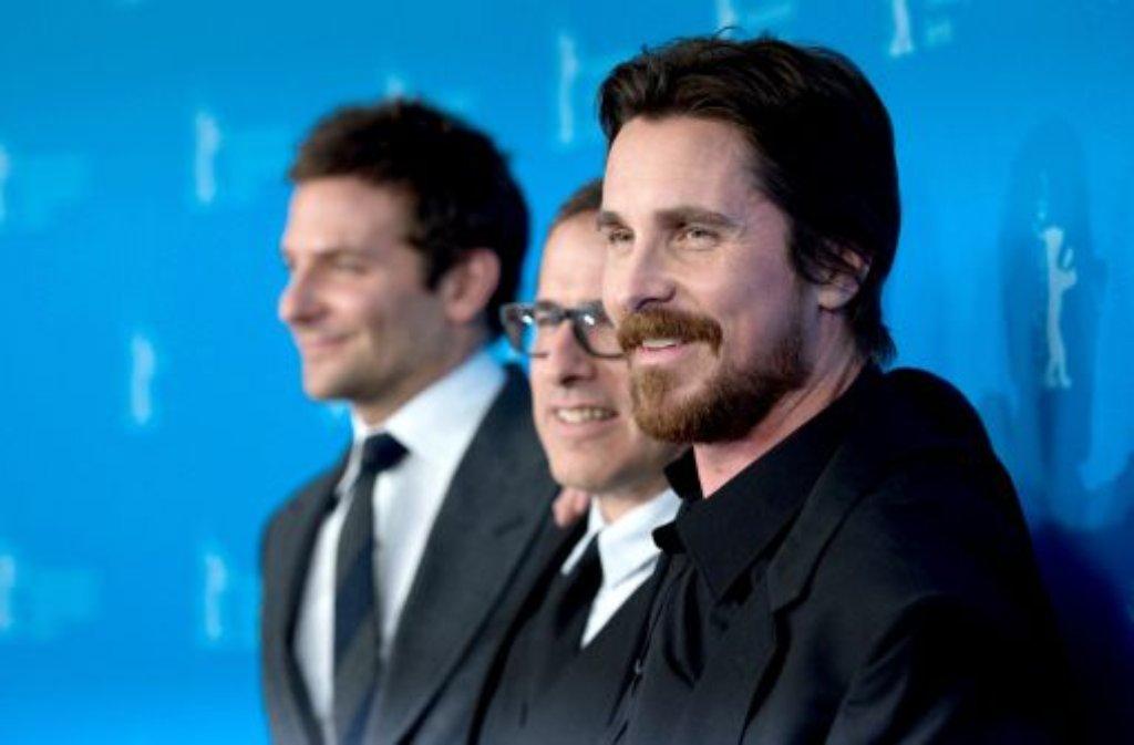 US-Schauspieler Bradley Cooper (von links),  US-Regisseur David O. Russell und der britische Schauspieler Christian Bale bei der Berlinale. Foto: dpa
