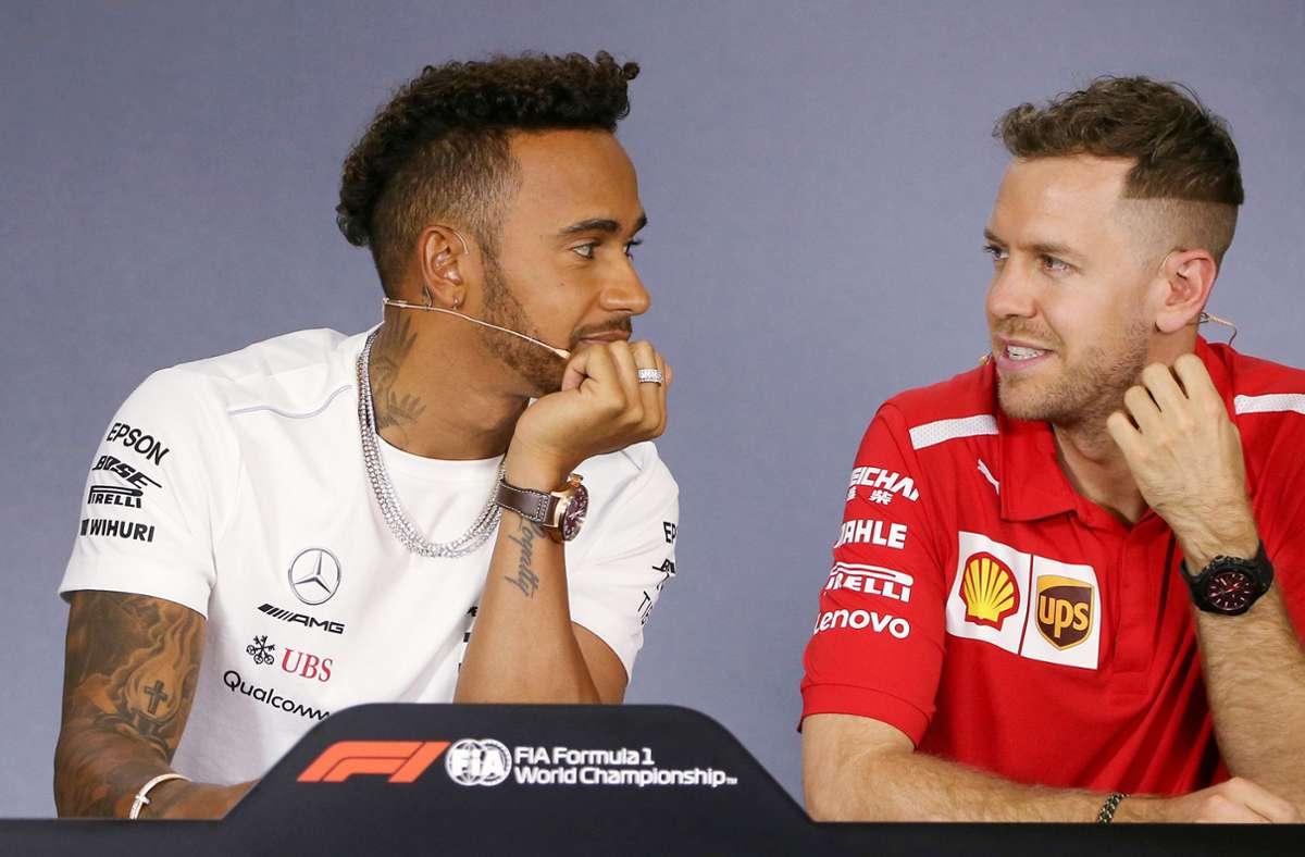 Zwei Mann, zehn Titel: Lewis Hamilton (links) und Sebastian Vettel dürfen wieder Gas geben. Foto: dpa/Rick Rycroft