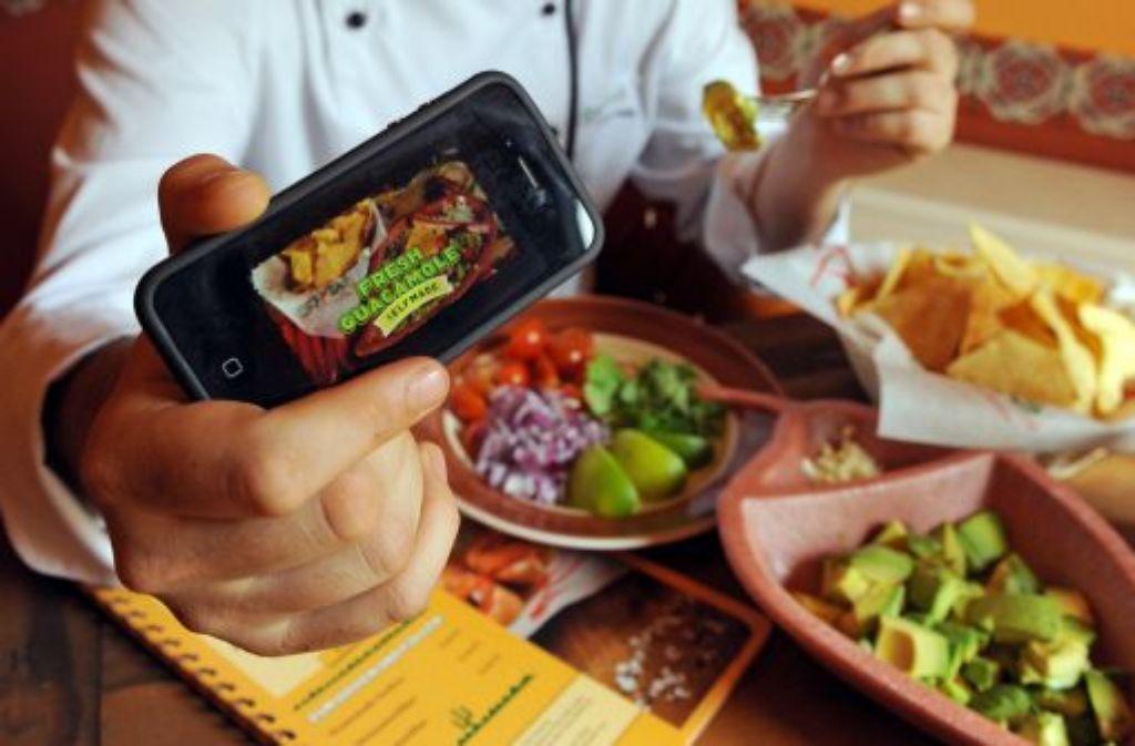 Bei der Fast-Food-Kette The Melt in San Francisco kann man sich die Warteschlange sparen und seine Bestellung über das Smartphone abgeben. Foto: dpa-Zentralbild