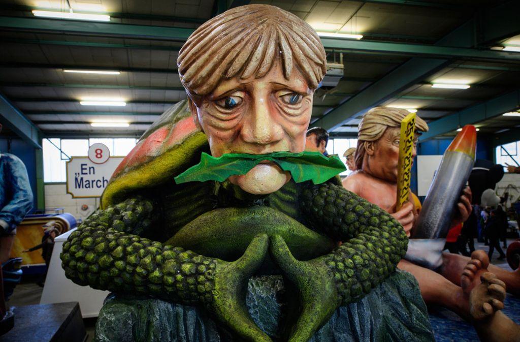"""""""Die letzte ihrer Art"""": Angela Merkel als Fossil. Foto: dpa"""