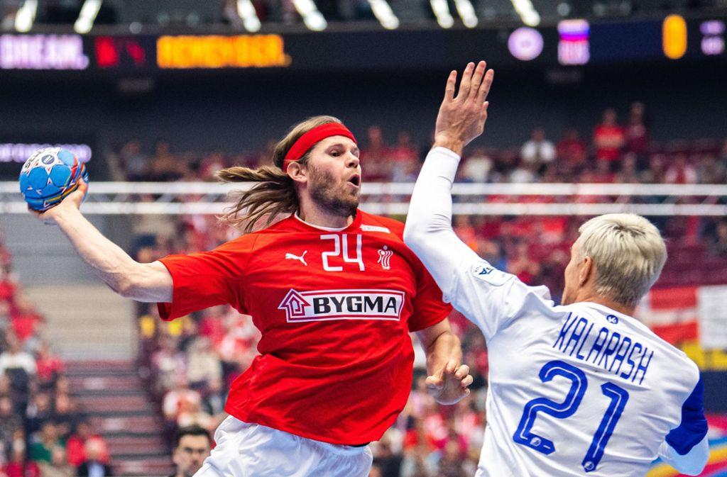 Dänemarks Star Mikkel Hansen (links) und seine Mannschaft sind raus. Foto: dpa/Petter Arvidson