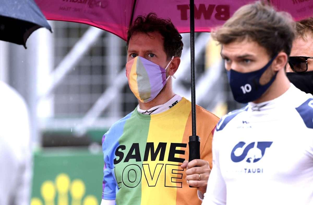 Sebastian Vettel (links) im Regenbogen-T-Shirt Foto: imago images/Laci Perenyi/Andre Jerry