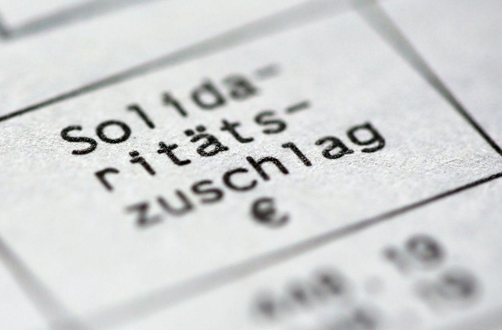 Nur noch die reichsten zehn Prozent der Steuerzahler müssen den Solidaritätszuschlag ab 2021 zahlen. Foto: dpa/Roland Weihrauch