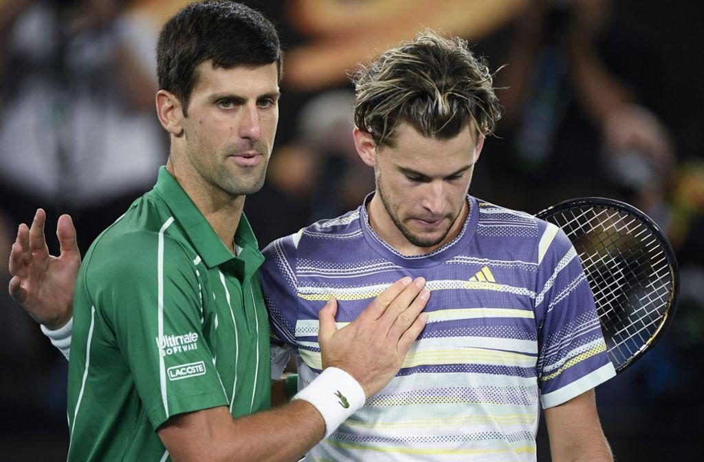Novak Djokovic setzte sich am Ende gegen den Österreicher Dominic Thiem (rechts) durch. Foto: AP/Andy Brownbill