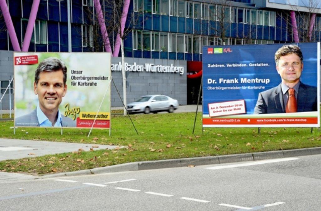 Endphase des Wahlkampfs um den OB-Sessel: an vielen Stellen der Stadt sind die  Wahlplakate der beiden aussichtsreichen Kandidaten zu sehen. Foto: dpa