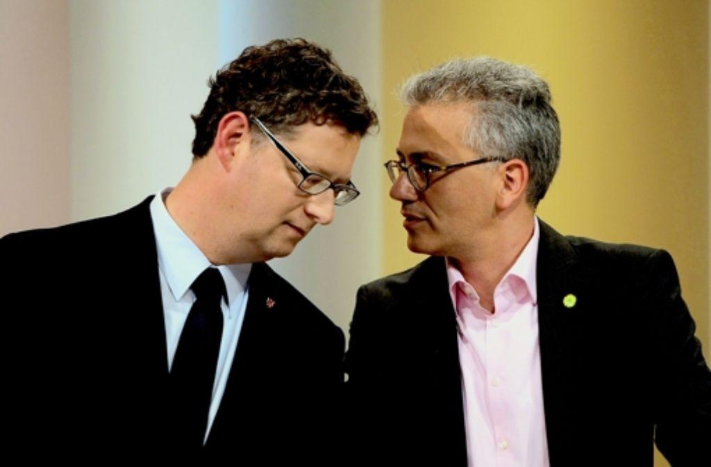 Thorsten  Schäfer-Gümbel  (SPD) und Tarek Al-Wazir (Grüne)  sondieren noch. Foto: dpa