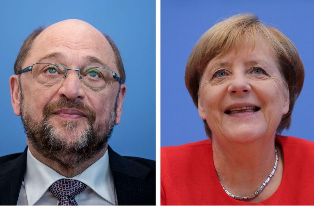 Auf dem Weg zur Vernunftehe? Martin Schulz und Angela Merkel kommen sich langsam näher... Foto: dpa