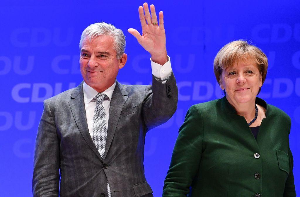 Die Bundeskanzlerin und CDU-Vorsitzende Angela Merkel und der Vize-Parteivorsitzende und baden-württembergische Innenminister Thomas Strobl in der Heidelberger Stadthalle. Foto: dpa