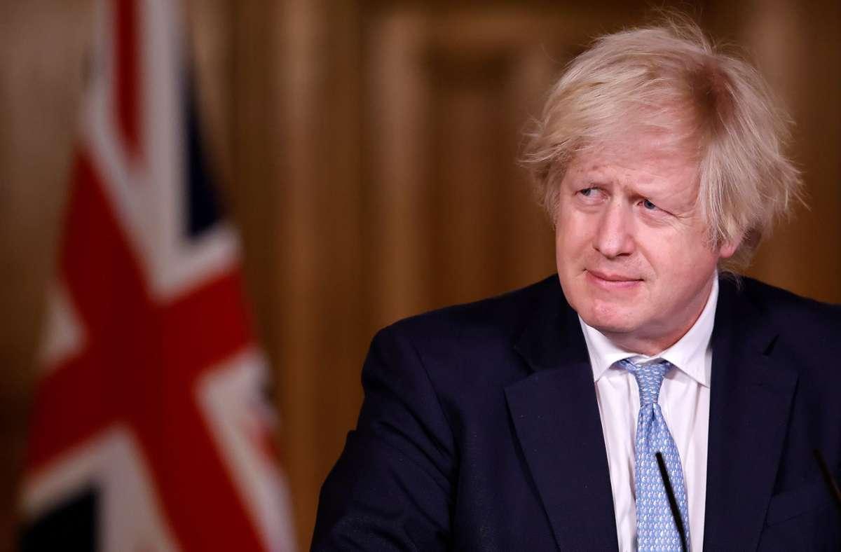 Boris Johnson muss sich etwa für eine Reise in die Karibik im Jahr 2019 rechtfertigen. (Archivbild) Foto: dpa/Tolga Akmen