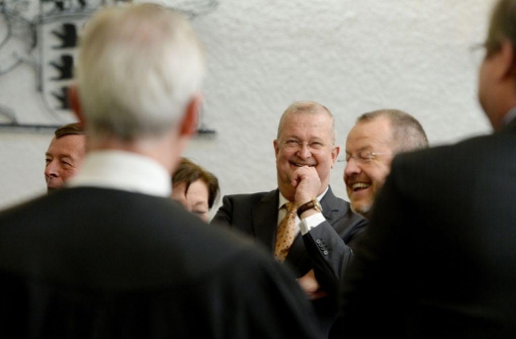Erleichterung nach dem Freispruch: die Ex-Manager Wiedeking, Härter im Landgericht. Foto: dpa