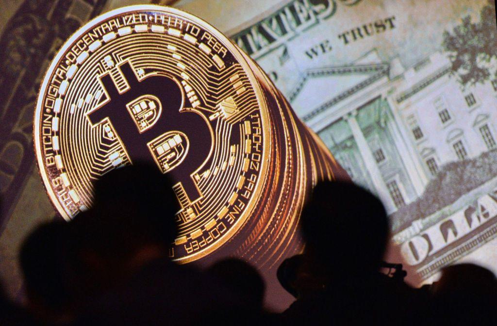 Bitcoins bestehen eigentlich aus Zahlencodes, diese Münze ist eine Art Gutschein. Foto: AFP