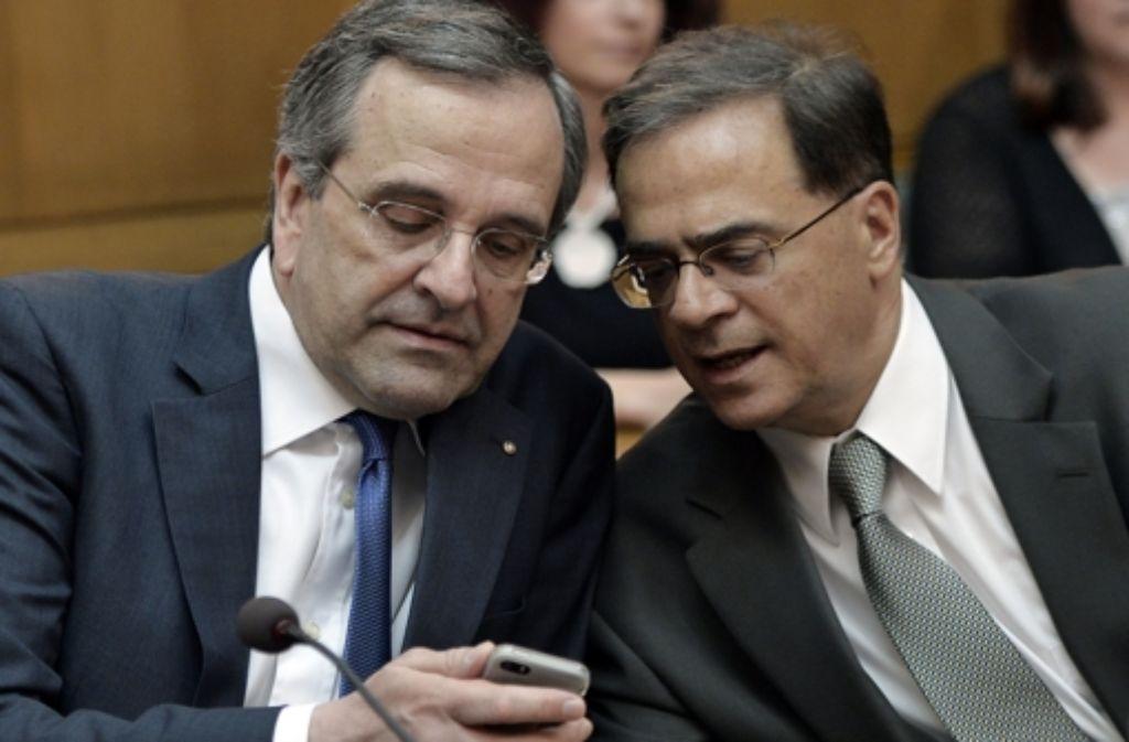 Griechenlands Premier Samaras (links) und der neue Finanzminister Hardouvelis Foto: AFP