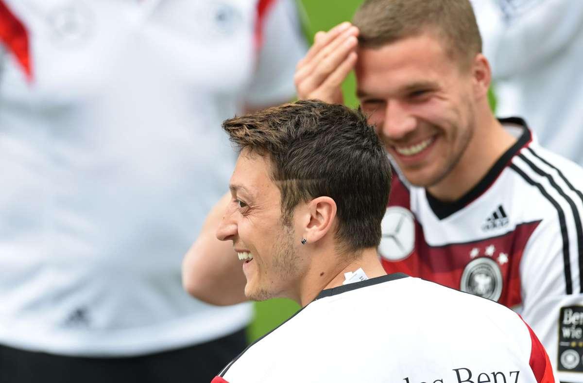 Waren gemeinsam erfolgreich: Mesut Özil und Lukas Podolski. Foto: dpa/Andreas Gebert