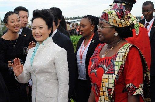 Chinas  Michelle stiehlt ihrem Mann die Show