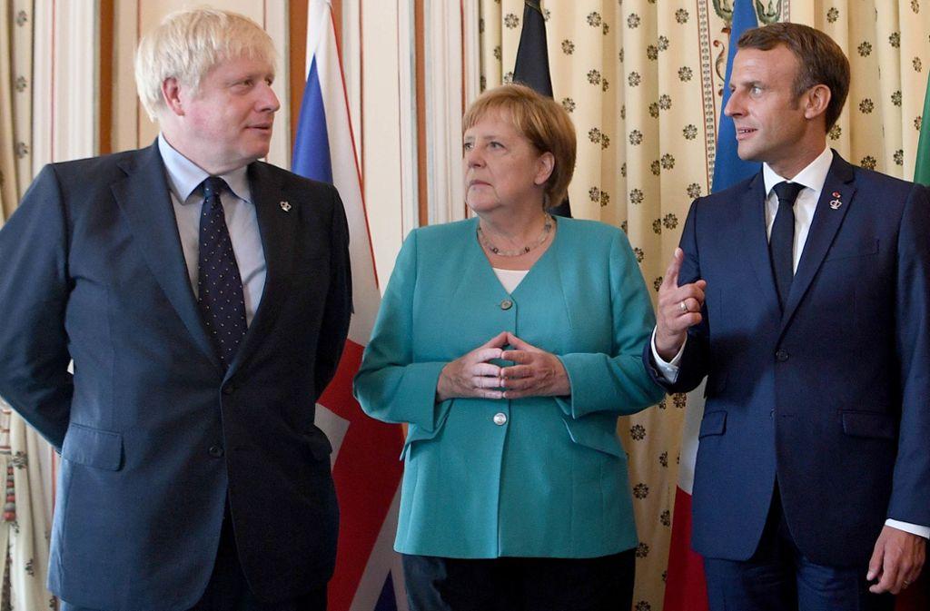 Boris Johnson mit Angela Merkel und Emmanuel Macron – schon beim jüngsten G7-Gipfel gab es keine Annäherung beim Brexit. Die Vorzeichen dafür haben sich jetzt noch verschlechtert. Foto: Getty Images