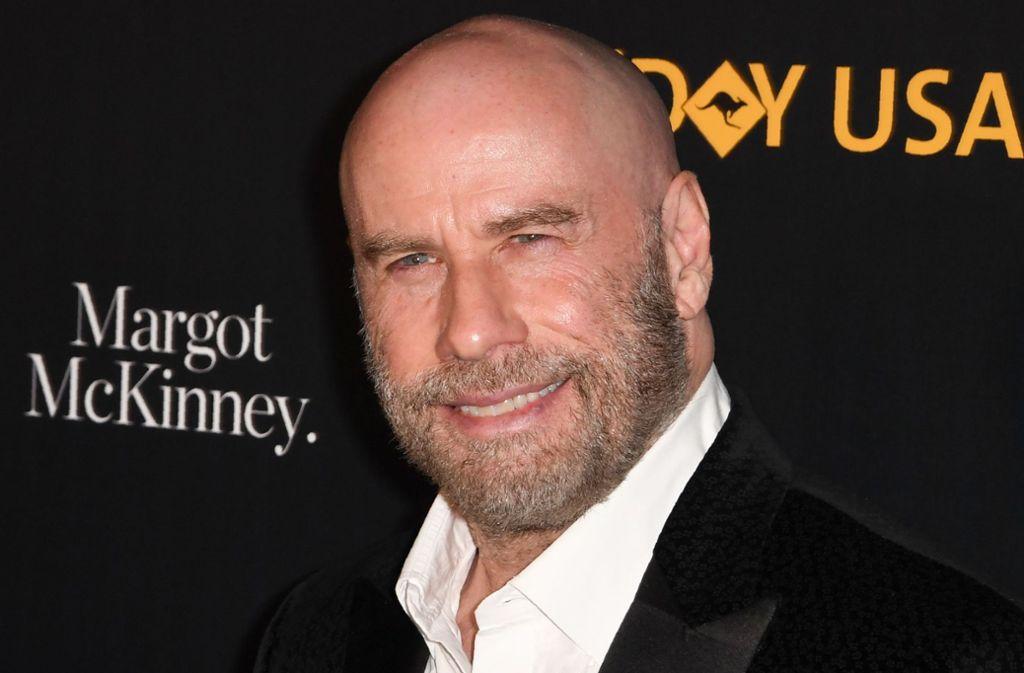 "Neuer Look für ""Mister Cool"": John Travolta liebt seinen Kahlkopf. Foto: AFP"