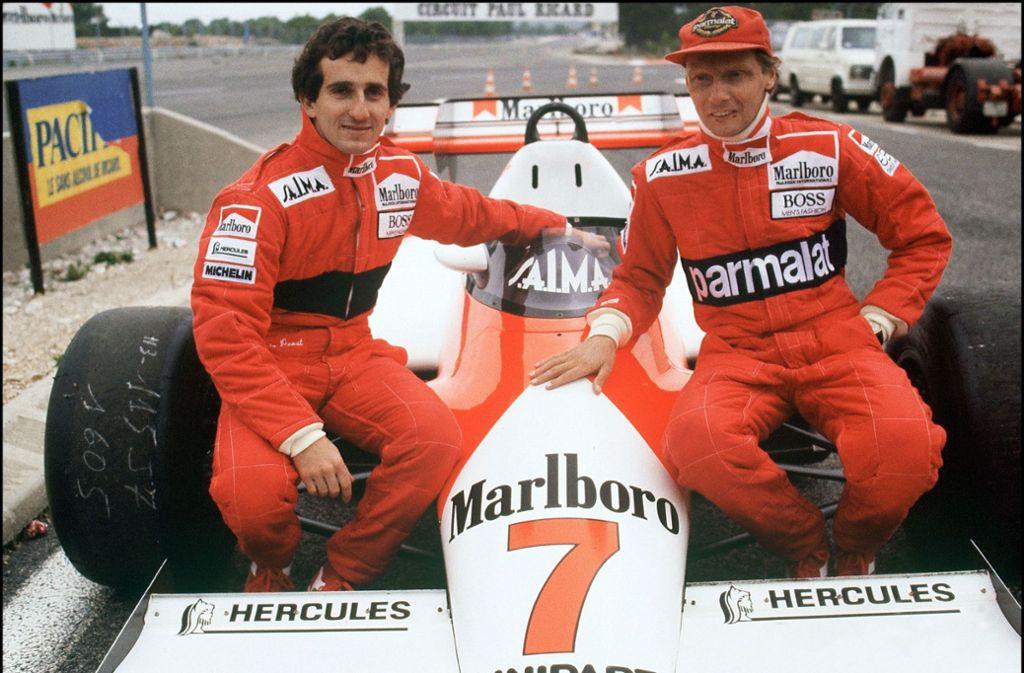 Niki Lauda (rechts) wollte verhindern, dass Alain Prost zu McLaren kommt. Vergeblich. In einem der größten Teamduelle der Formel-1-Geschichte wurde  Lauda 1984 mit einem halben Punkt Vorsprung Weltmeister vor Prost. Foto: AFP