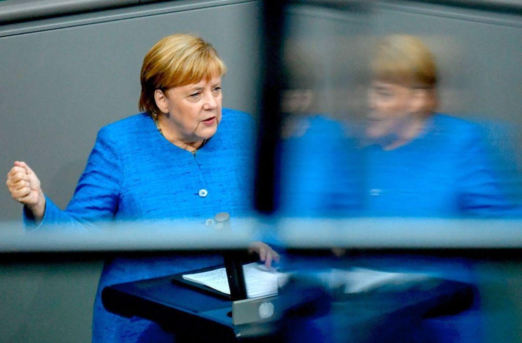 Angela Merkel hat am Mittwoch im Bundestag für die weitreichende Entscheidungen zum Klimaschutz geworben, die ihr Kabinett nächste Woche treffen will. Foto: AFP/John MacDougall