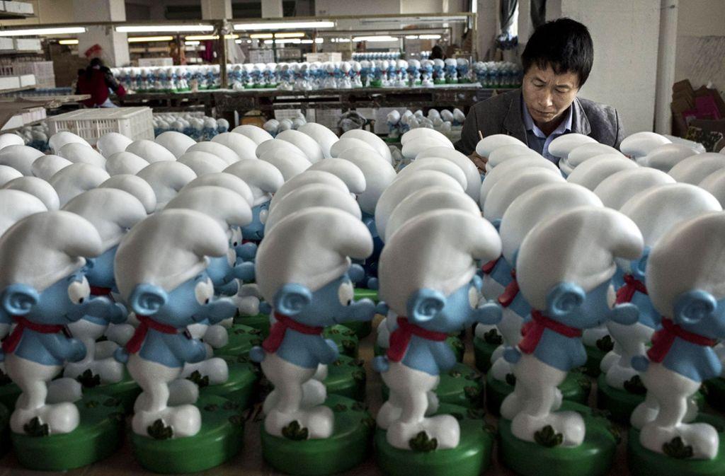 Ein Blick in Chinas Schlumpf-Fabriken zeigt: Die kleinen Wichte sind immer noch gefragt. Foto: Getty