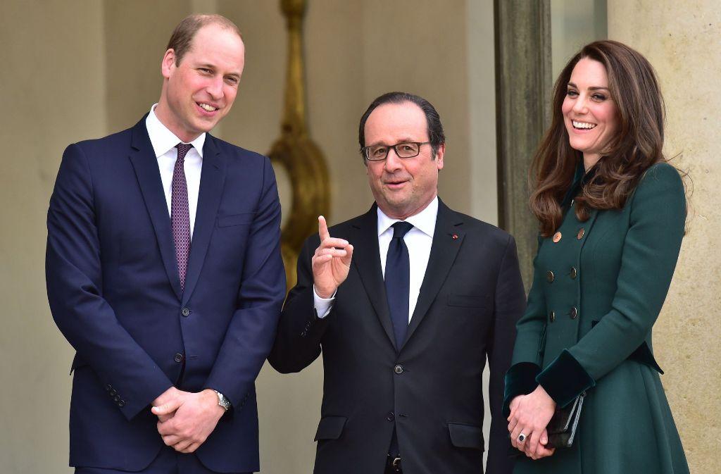 Prinz William und Herzogin Kate sind vom französischen Staatschef Francois Hollande im Elysee Palace empfangen worden. Kate trägt am St. Patricks Day natürlich Grün. Foto: PA Wire