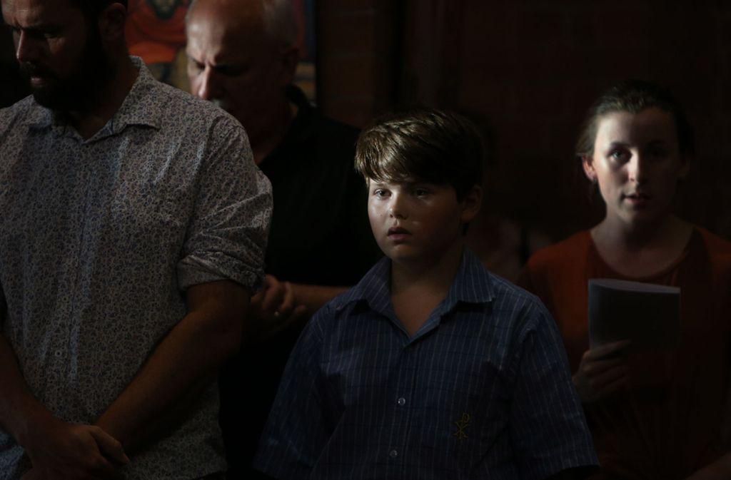 Ein Junge in Grafton (Australien) singt in einer Messe für die Anschlagsopfer. Foto: Getty Images AsiaPac