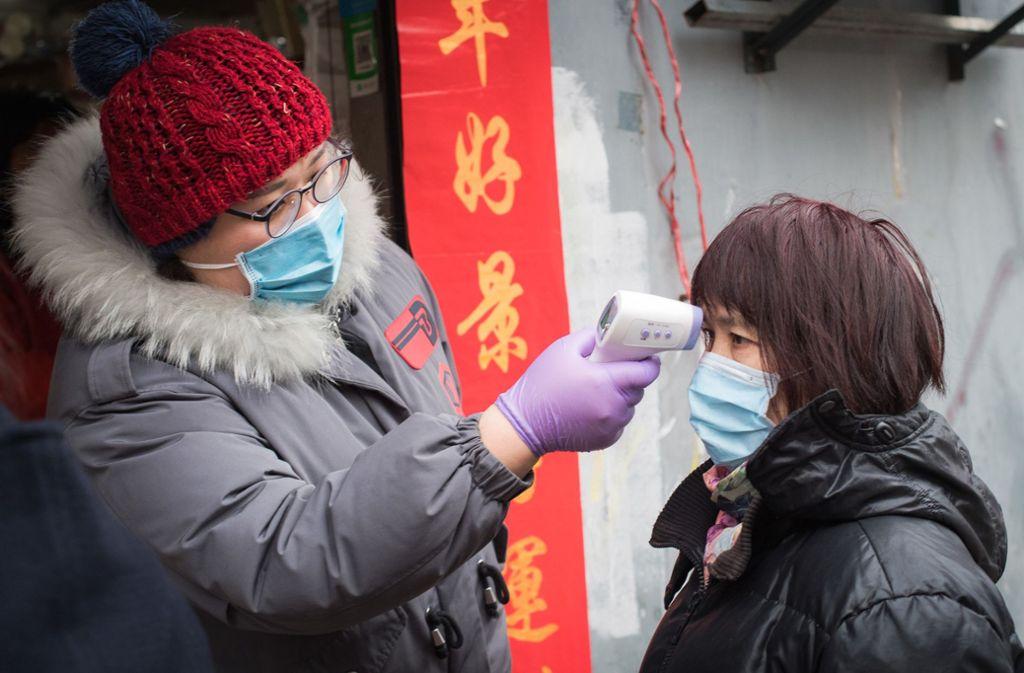 In China gibt es landesweit fast 64 000 Corona-Fälle. Foto: dpa/Xiao Yijiu