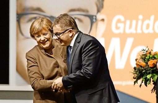 Angela Merkel und ihr Südwest-Spitzenmann Guido Wolf. Foto: dpa