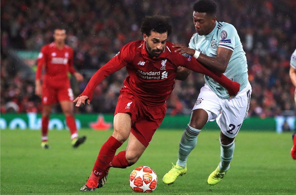 Mo Salah (li.) gegen David Alaba: Kann sich der FC Liverpool im Rückspiel beim FC Bayern durchsetzen? Foto: dpa