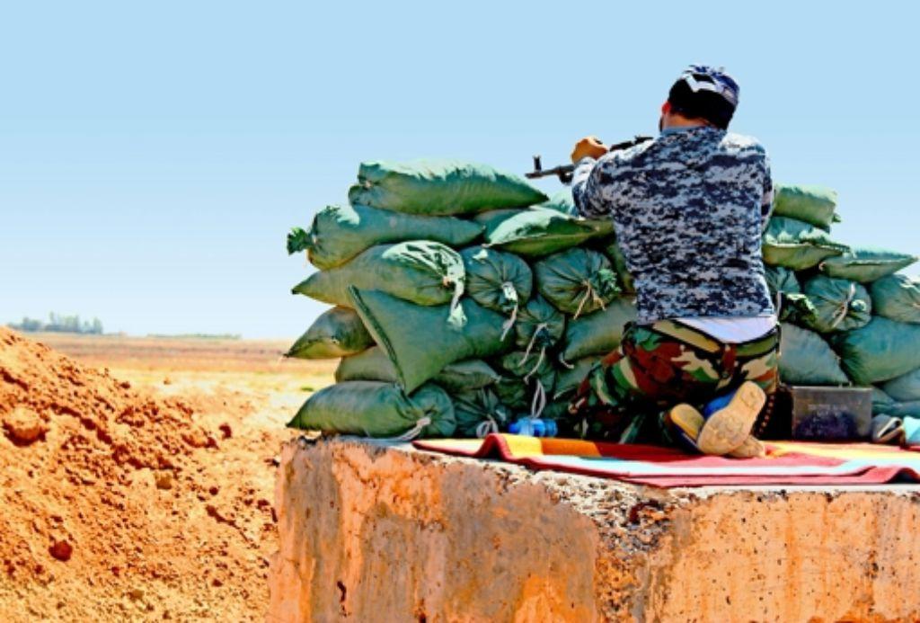 Kurdische Peschmerga-Milizen trotzen dem Vormarsch der Islamisten. Foto: AFP