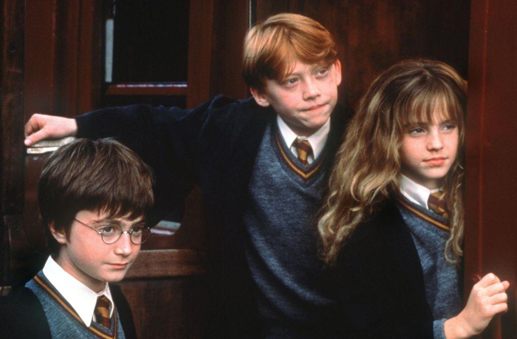 Diesen markanten Rotschopf kennt jeder: Rupert Grint (Mitte) alias Ron Weasley. Foto: dpa-Film