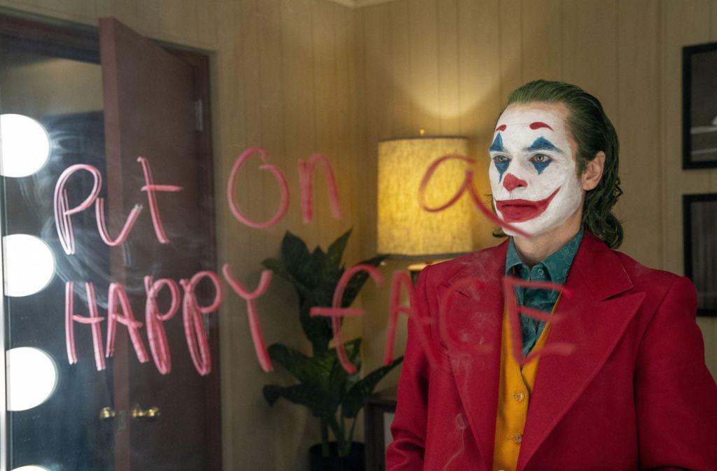 Abschreckende Figur oder gefährliches Vorbild   – Joaquin Phoenix als Joker. Foto: AP/Niko Tavernise