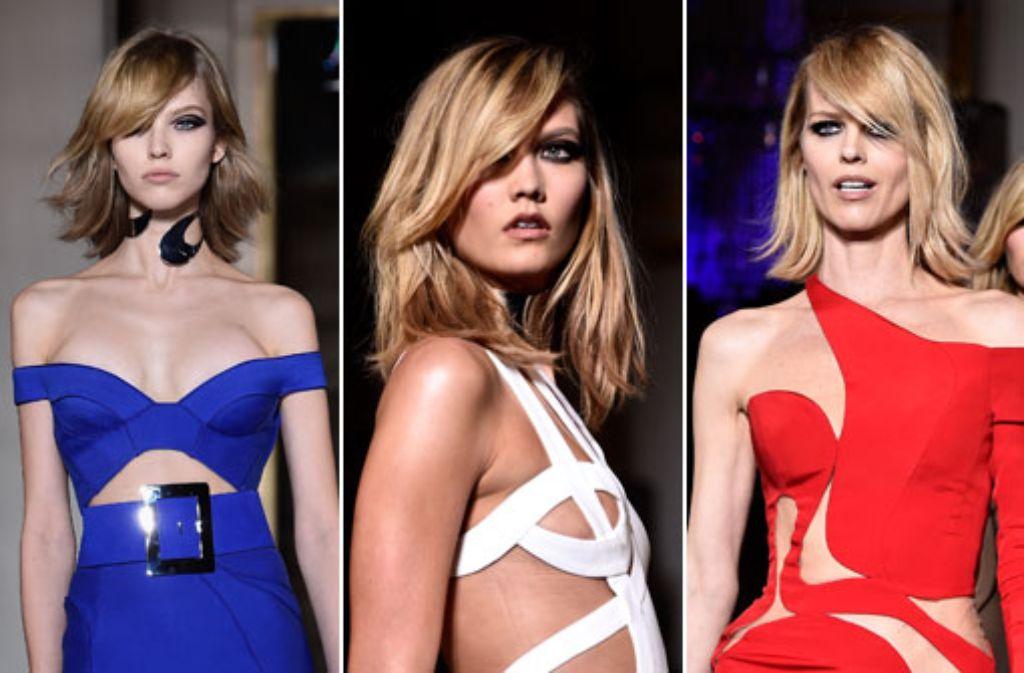 Donatella Versace schickte Karlie Kloss (Mitte) und Eva Herzigova (rechts) bei den Pariser Haute-Couture-Schauen in den Farben der Trikolore über den Laufsteg. Foto: Getty Images