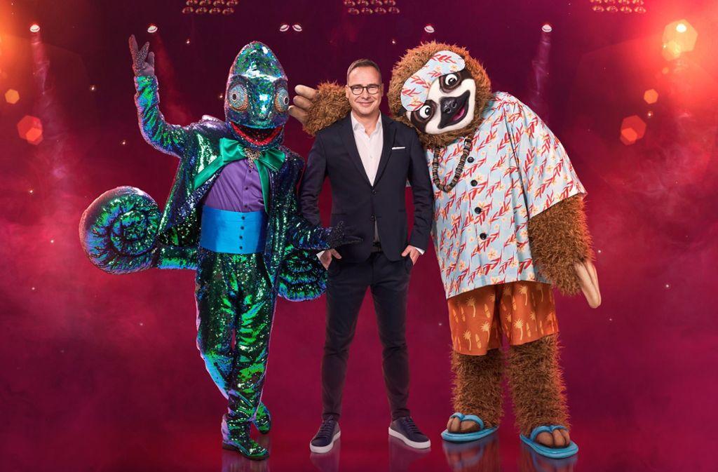 Das Chamäleon und das Faultier werden in der neuen Staffel der ProSieben-Sendung The Masked Singer auftreten. Foto: dpa/ProSieben